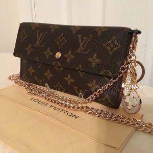 Louis Vuitton Portefeiulle Int'l Wallet Crossbody